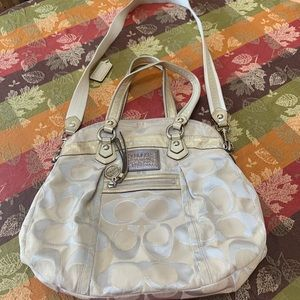Authentic gold Coach Handbag. Slightly used.